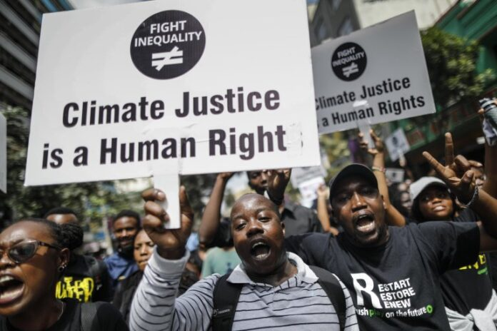 """""""Climate Justice IS a Human Right"""""""